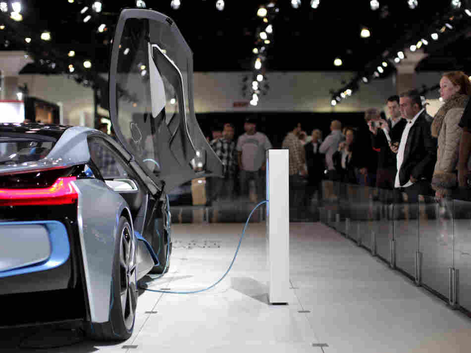 Attendees at the Los Angeles Auto Show look at the BMW i8 plug-in hybrid concept car. Toyota's Prius is the best-selling hybrid on the market, but almost every carmaker has some form of hybrid technology.