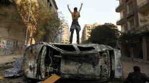 Earlier today a protester stood on top of a burned car in Tahrir Square in Cairo, Egypt.