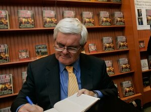 Former Speaker of the House Newt Gingrich signs a copy of his book 'Pearl Harbor: A Novel of December 8th' at a Barnes and Noble bookstore May 15, 2007 in New York City.