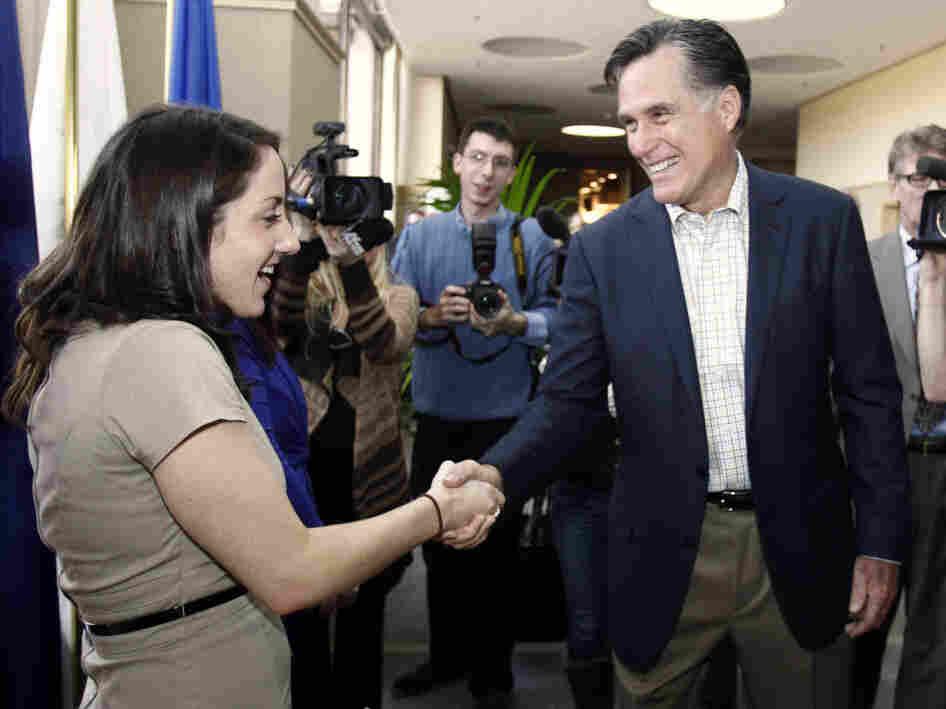 Mitt Romney greets BAE Systems employee Ashley Bournival in Nashua, N.H., Monday, Nov. 21, 2011.
