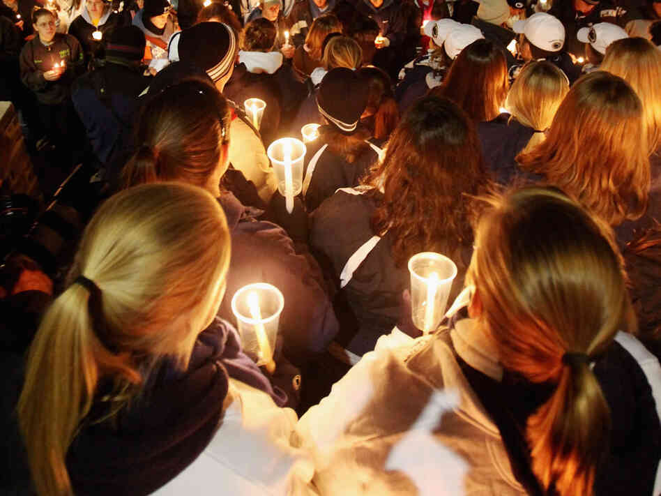 Penn State students and supporters gather for a candlelight vigil for victims of child abuse in front of Old Main in the wake of the sex abuse scandal on in State College, Pennsylvania.