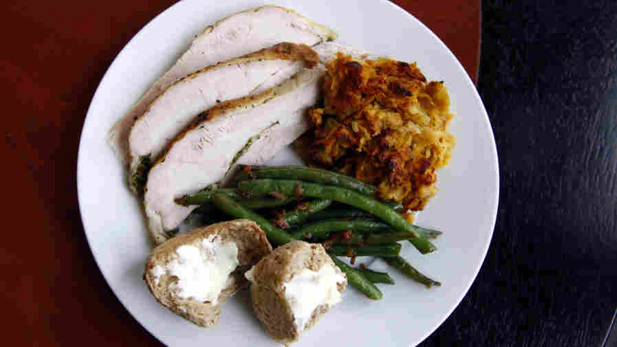 "Chris Kimball uses ""secret"" ingredients to make his Thanksgiving dishes special, including herb roasted turkey, green beans, corn-flake stuffing and multigrain rolls. And for dessert, he made a spiced pumpkin cheesecake."