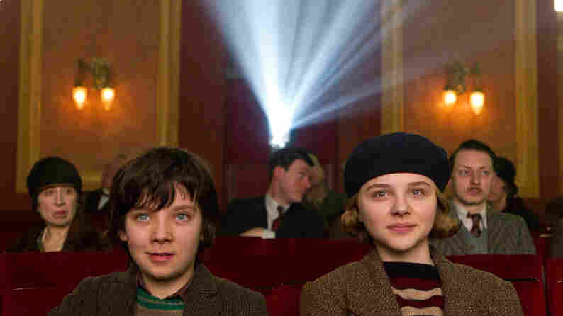 Orphan Hugo Cabret (Asa Butterfield and his vivacious new friend Isabelle (Chloe Grace Moretz) marvel at the magic of the motion picture in Hugo.