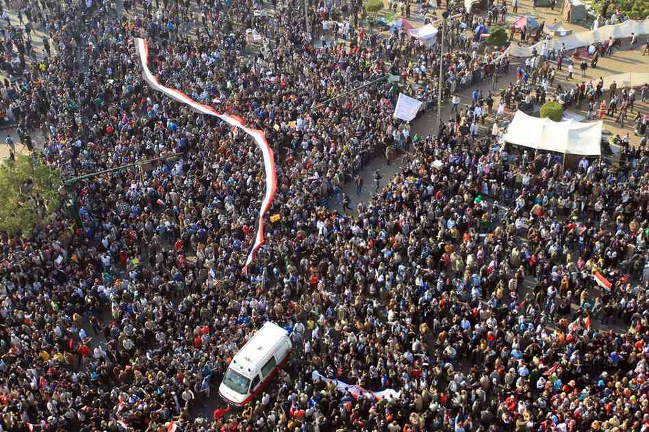 Thousands of people attend a rally in Tahrir Square to demand that the ruling military council cede power to a civilian government.