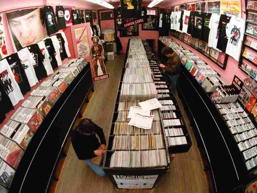 Shoppers peruse the record racks in the Vintage Vinyl record shop in Evanston, Il, one of hundreds of independent record stores around the country where you'll be able to find exclusive material this Friday.