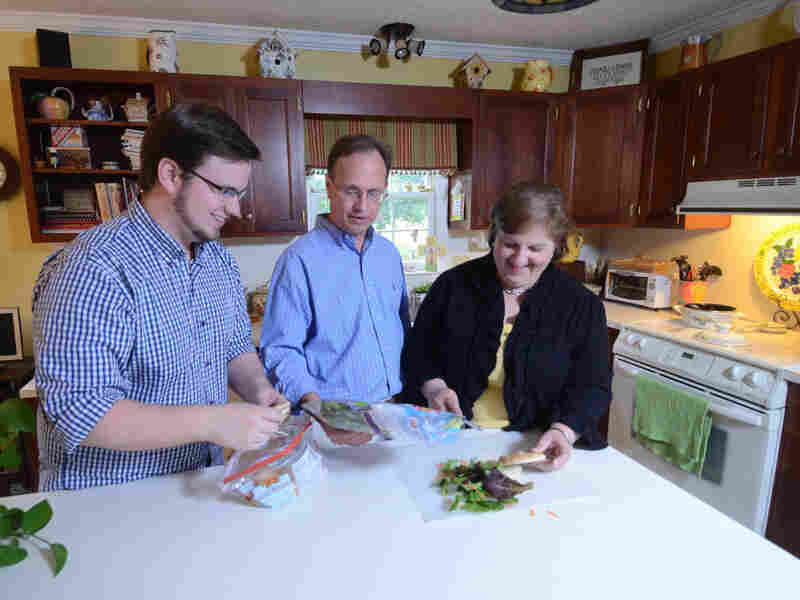 Brian Griffith (left), shown here in 2009 at age 26, moved home with his parents, Jay and Jennifer Griffith, after losing his job. The tight job market, especially for college grads, has prompted many young adults to move back in with their parents.