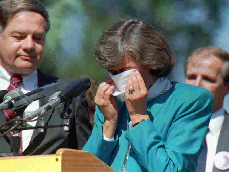 U.S. Rep. Patricia Schroeder wipes her eyes at a 1987 news conference in Denver.