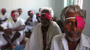 Patients sit after their cataract surgeries at a hospital of the Aravind Eye Care System in Madurai, India.