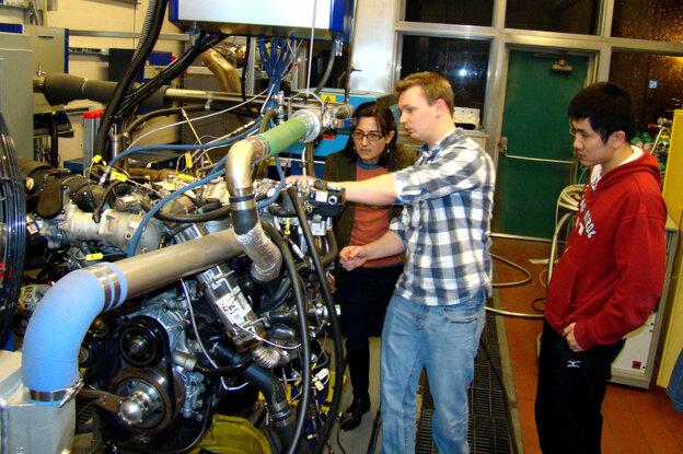 Professor Anna Stefanopoulou (left) examines a V8 internal comb