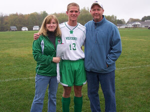 "High school senior Jared Lyons (center), shown here with his parents, Kim and Bob, worries how he'll afford to achieve his dream of becoming a doctor. The economy, he says, ""can't get any worse than it is now."""