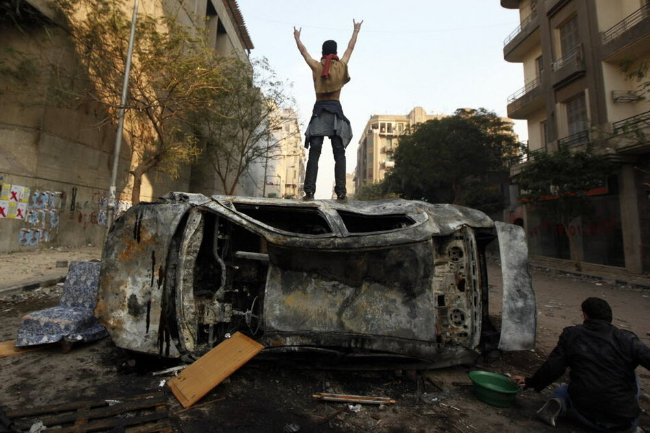 An anti-government demonstrator stands defiant in Tahrir Square, which was the epicenter of the uprising that ousted President Hosni Mubarak in February.  (AP)