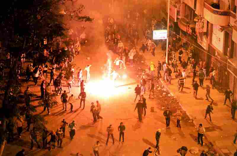 In the coastal city of Alexandria, scores of demonstrators, including thousands of students, take to the streets.
