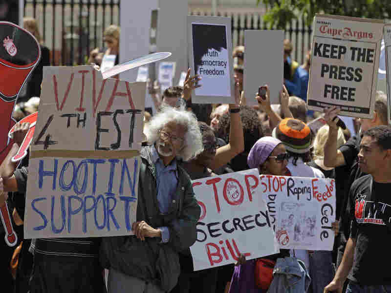 Protesters hold placards opposing the controversial Protection of State Information Bill at Parliament in Cape Town, South Africa, on Tuesday.