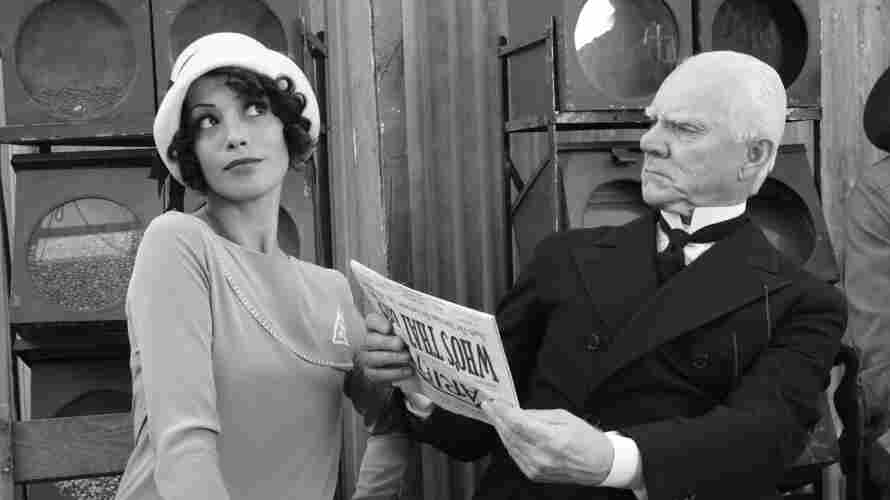 On The Rise: Up-and-coming actress Peppy Miller (Berenice Bejo) gets recognized by another extra (Malcolm McDowell) after getting her big break in the talkies.