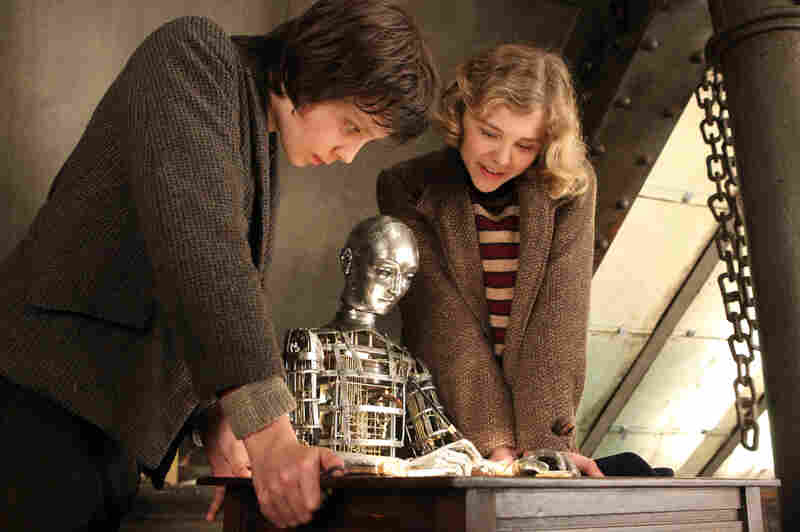 With his companion Isabelle (Chloe Grace Moretz), Hugo hopes to finish rebuilding an automaton his father had once dreamed of restoring.