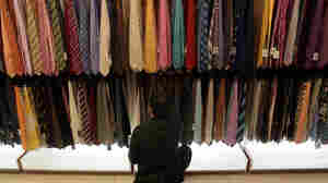 A man browses through ties at a Century 21 department store November 26, 2010 in New York City.