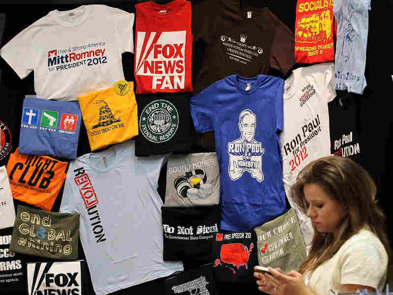 T-shirts on display at the 2011 Republican Leadership Conference in New Orleans in June. With the holidays approaching, campaigns and retailers are hawking plenty of political merchandise.