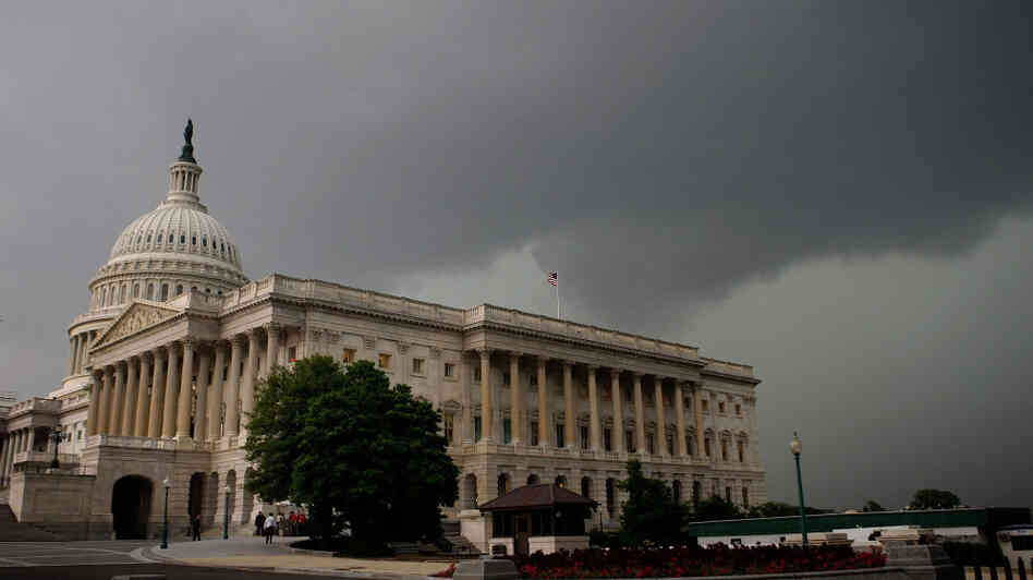 A dark cloud passes over the U.S. Capitol in Washington, D.C. Many lawmakers fear that Congress' already low approval rating will sink even further after the failure of the supercommittee.
