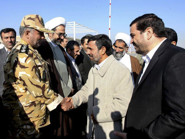 Iranian President Mahmoud Ahmadinejad shakes hands with an unidentified army colonel in Shahr-e-Kord, Iran, Nov. 9, 2011.