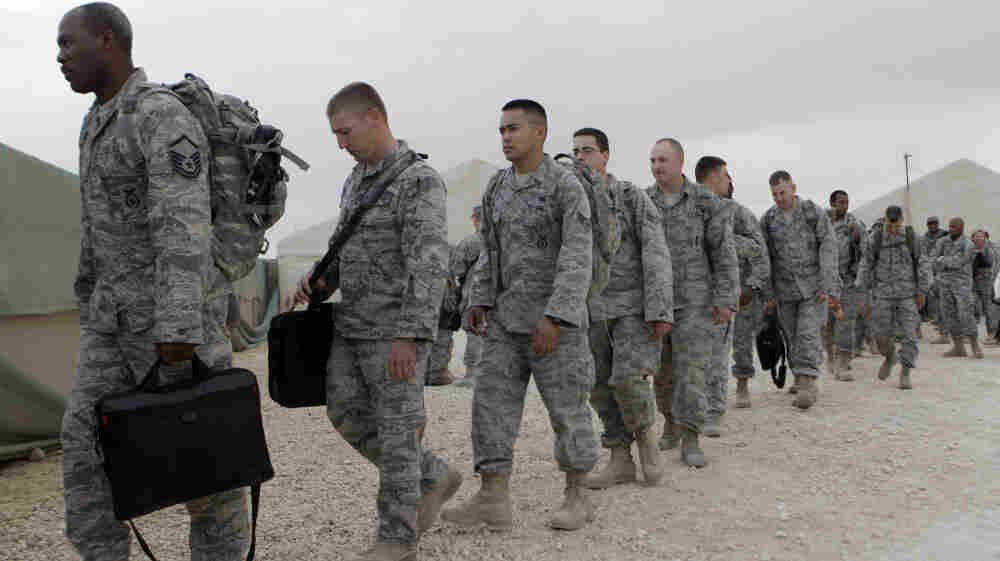 U.S. servicemen line up to board a bus as they begin their journey home at Al Asad Air Base west of Baghdad, Iraq, on Nov. 1. The U.S. has promised to withdraw from Iraq by the end of the year as required by a 2008 security agreement between Washington and Baghdad. Some 39,000 U.S. troops are scheduled to clear out along with their equipment.