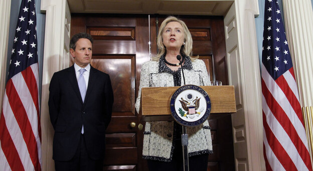 Secretary of State Hillary Clinton speaks while Treasury Secretary Tim Geithner looks on during a Nov. 21 news conference about new sanctions against Iran.