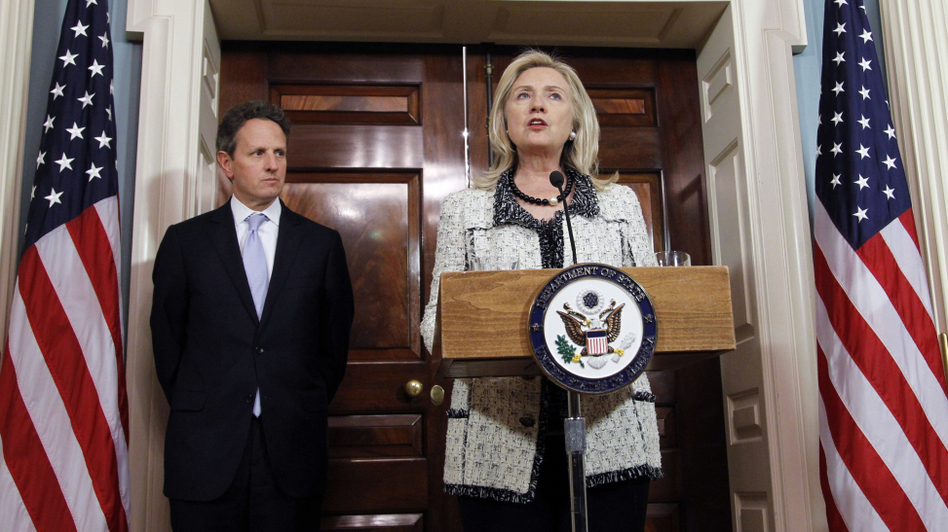 Secretary of State Hillary Clinton speaks while Treasury Secretary Tim Geithner looks on during a Nov. 21 news conference about new sanctions against Iran.  (AP)