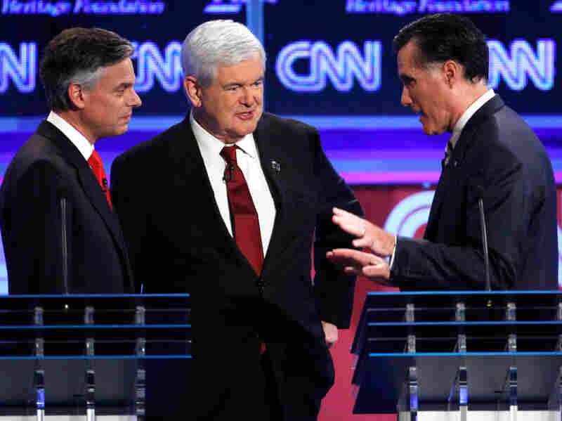 Republican presidential candidates former Utah Gov. Jon Huntsman, former House Speaker Newt Gingrich and former Massachusetts Gov. Mitt Romney at a GOP presidential debate in Washington on Nov. 22, 2011.