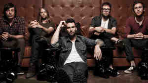 Adam Levine (center) and the rest of Maroon 5.