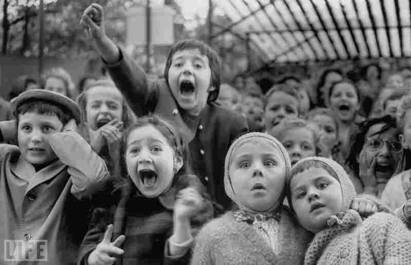 Here's the photo you may have seen: A charming moment at the Tuileries in Paris, 1963. Children are watching a play, and photographer Alfred Eistenstaedt clicks the shutter at the exact moment when St. George slays the dragon.