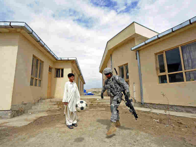 U.S. Army Sgt. Johnny Hoyos plays soccer with an Afghan boy at a school in Qalat, Afghanistan on April 16 in Qalat. U.S. troops were visiting to assess the facilities for a renovation project.