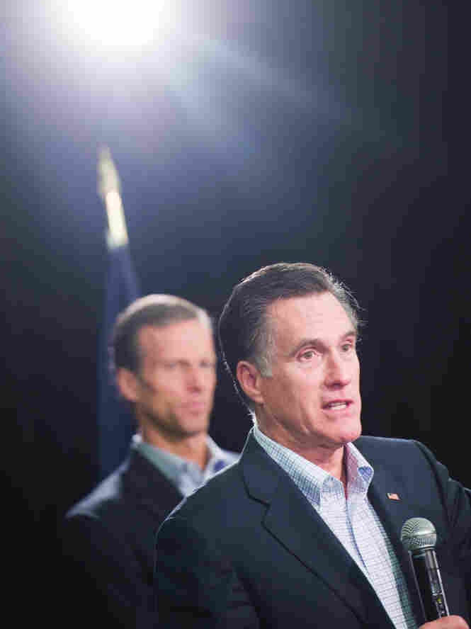 Mitt Romney, shown with Republican Sen. John Thune of South Dakota, speaks to Nationwide Insurance employees Wednesday in Des Moines, Iowa. Thune, once considered a potential candidate himself, has endorsed Romney in the GOP race for the presidential nomination.