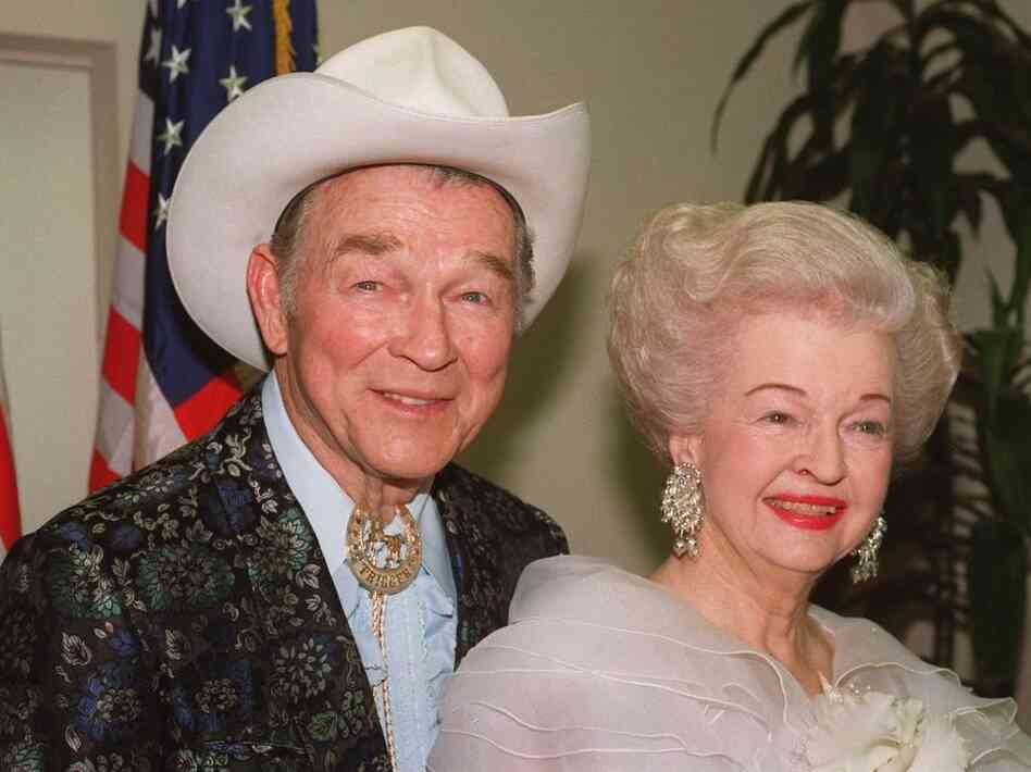 Actors Roy Rogers and Dale Evans are sh