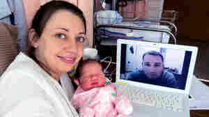 """Lindsey, Natalie and Paul Santana (seen via webcam), the day after Natalie's birth. """"The hospital staff was so incredible to arrange for the Internet connection to make that possible,"""" Lindsey says. She calls their Skype chat that day """"such a great memory for us."""""""
