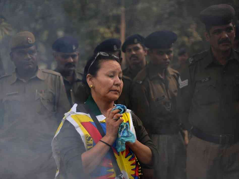 A Tibetan protester takes part in a prayer during an anti-Chinese rally by the Tibetan people's solidarity movement near the Chinese embassy in New Delhi on Nov. 23, 2011.