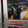 Shoppers wait to get inside of a Best Buy store on Nov. 25 in Naples, Fla.