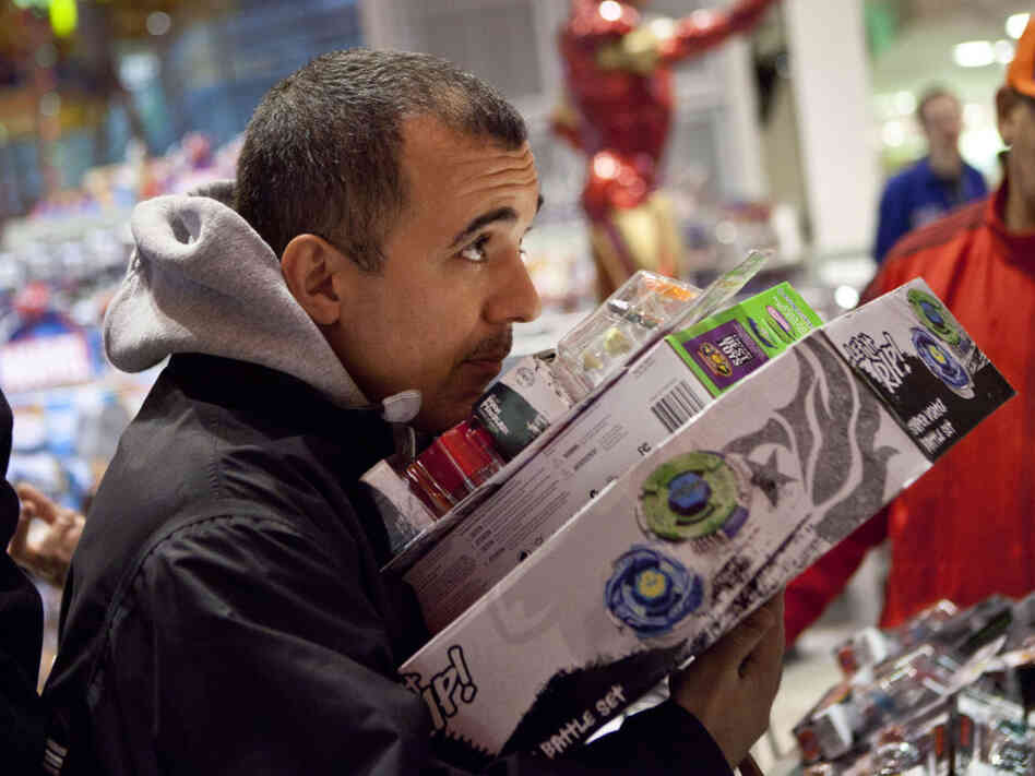 A holiday shopper at the Toys R Us in New York's Times Square.