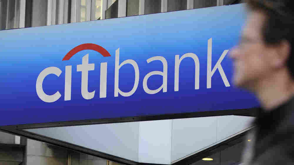 A man walks by a Citibank branch at the U.S. bank Citigroup world headquarters on Park Avenue, in New York in 2008.