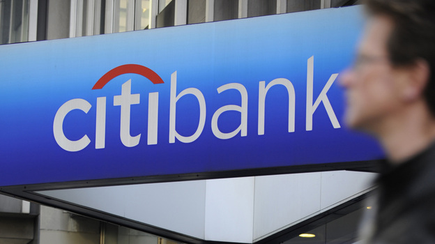 A man walks by a Citibank branch at the U.S. bank Citigroup world headquarters on Park Avenue, in New York in 2008. (AFP/Getty Images)
