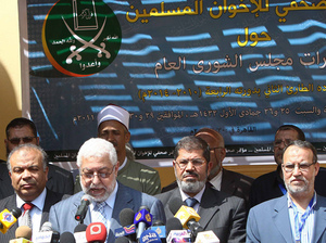 Members of Egypt's Muslim Brotherhood take part in a press conference in Cairo on April 30, to announce the formation of a new party, the Freedom and Justice Party, to contest up to half of parliament's seats in a September election.