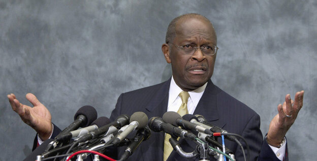Republican presidential candidate Herman Cain speaks on Capitol Hill in Washington.