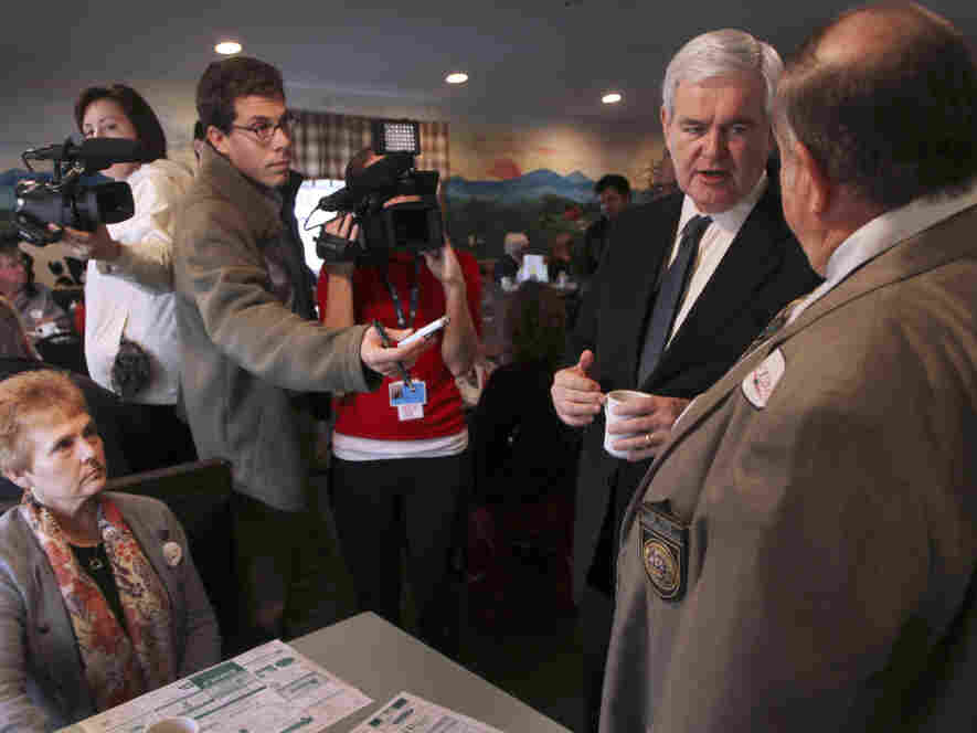 Newt Gingrich talks to New Hampshire State Rep. Joe Pitre during a campaign stop at the Circle Restaurant in Epson, NH.  Friday, Nov. 11, 2011.