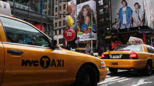 Taxis pass through Times Square in New York City.