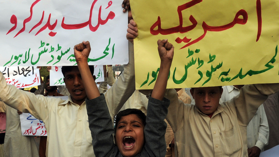 Pakistani boys in Lahore joined in a protest Sunday about the NATO attacks that killed 24 Pakistani soldiers. (AFP/Getty Images)