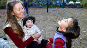 Michele Pereira, who questions the schedule of mandatory vaccines, sat with her daughters, Evangeline, 6, right, and Genevieve, 2, at a park in Ashland, Ore., earlier this month.