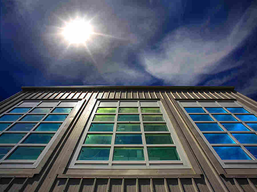 Researchers at the window testing facility at Lawrence Berkeley National Laboratory are developing dynamic windows treated with nanocrystals that block heat from the sun when a small electrical current is applied — useful for hot summer days.