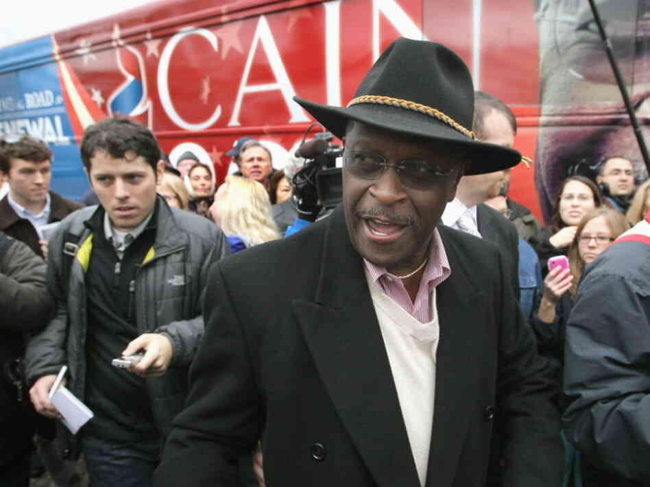 Herman Cain leaves the Big Sky Diner on Nov. 10, 2011 in Ypsilanti, Mich.