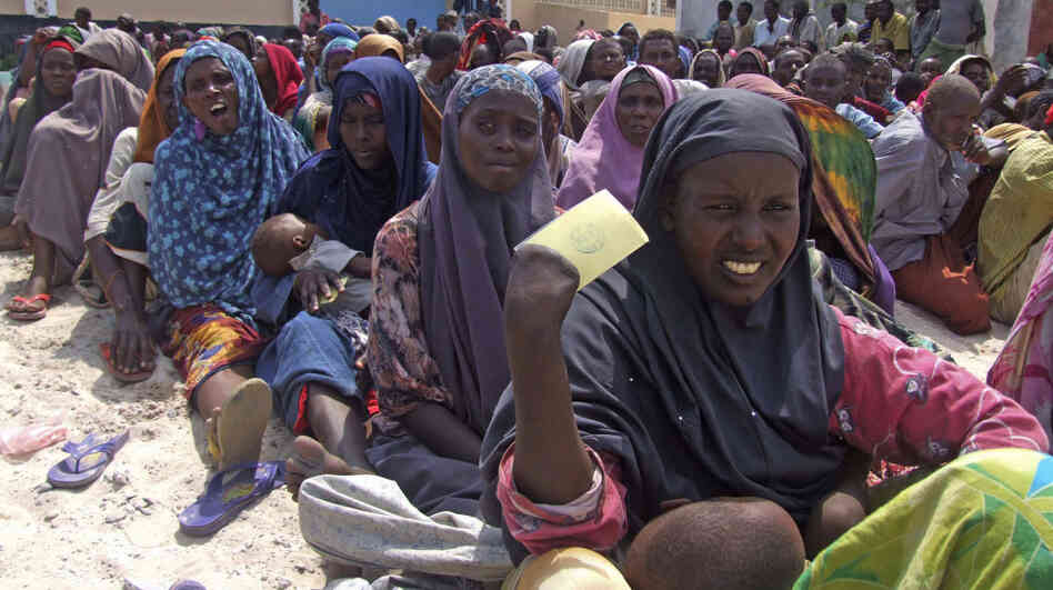 Somali civilians line up for food during the famine this year. Militants are banning relief agencies who warn a quarter of a million