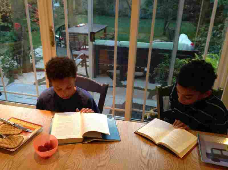 Brothers Adin (left) and Julian H., who live in the Westchester district of Los Angeles, read The Phantom Tollbooth over breakfast.