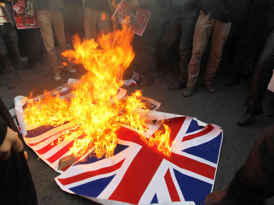 Iranian protesters burned the British flag outside the embassy in Tehran today (Nov. 29, 2011) and then stormed inside, according to news reports.