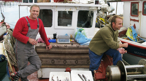 In the Greek village of Volos, fisherman Christos Xegandakis (left) jokes bitterly that times have gotten so tough that he may have to start swapping his fish for other goods. Others in Volos have already turned to barter systems, both formal and informal, in order to make ends meet.
